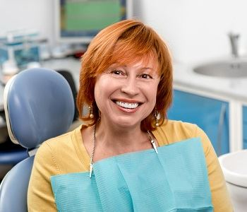 woman feeling comfortable and smiling at the dentist's