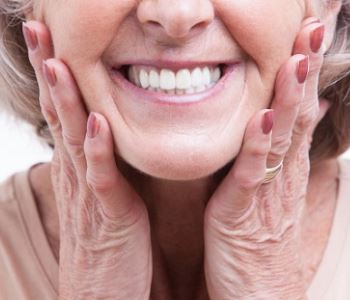 senior woman with beautiful smile after dental implant Procedure from Dr. David Spilkia
