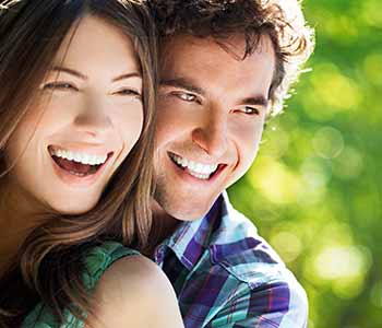 Smilling couple showing their brighter teeth