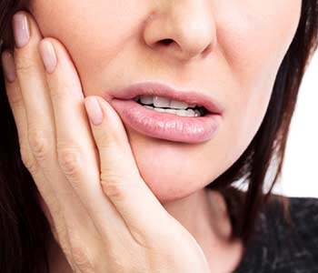 Matured lady suffering from tooth pain